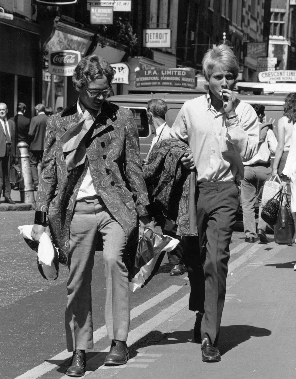 Two young men walk down London's Carnaby Street in 1967