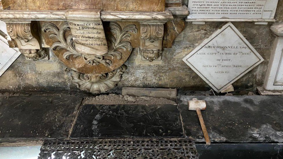 The final stone to be installed in the restoration of Bath Abbey's historic floor