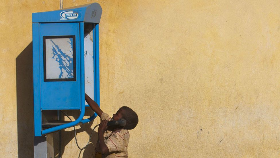 Boy using a pay phone in Asmara, 2013