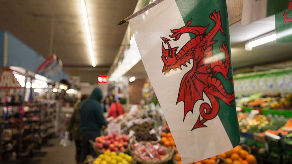 A Welsh flag is displayed in the market in Aberdare