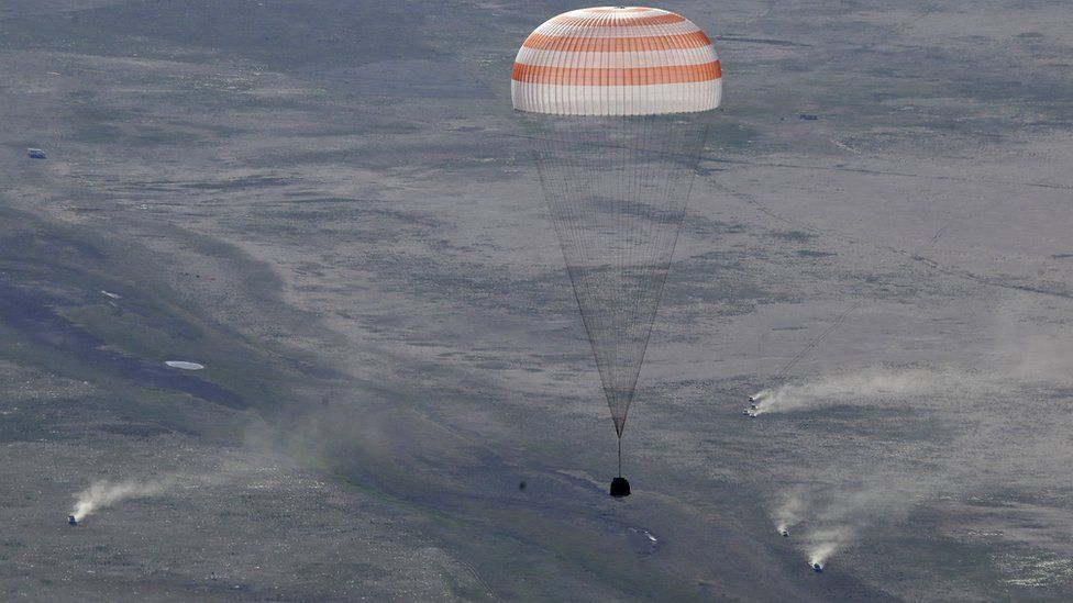 Soyuz space capsule brings ISS crew back after five month mission