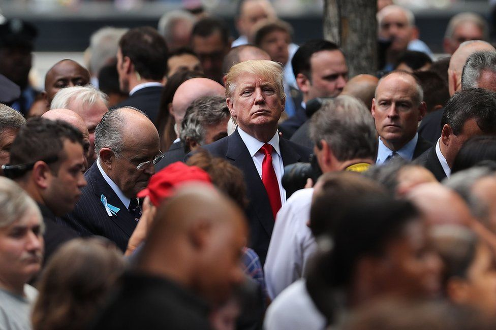 Republican presidential candidate Donald Trump (C) attends a commemoration ceremony for the victims of the September 11 attacks at the National September 11 Memorial and Museum in New York, 11 September