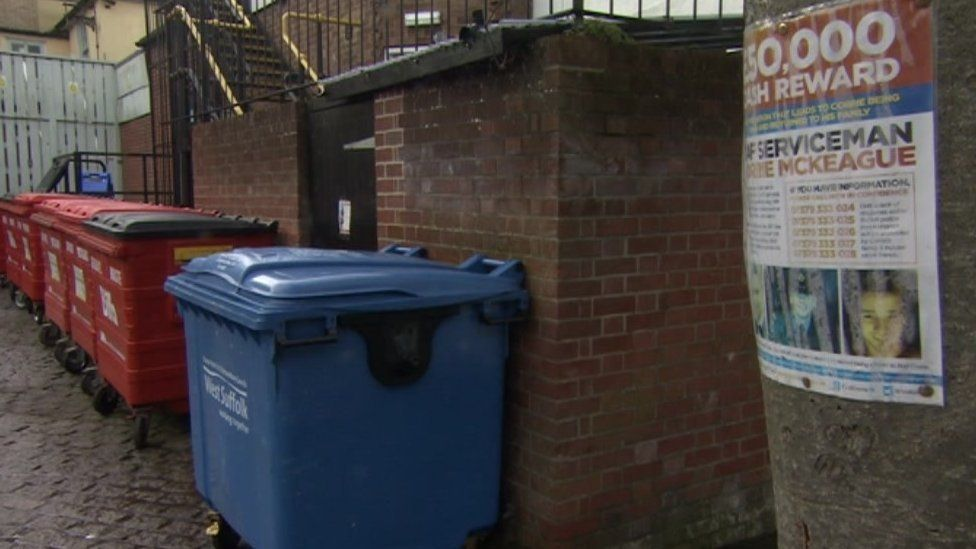 Bins and a missing poster