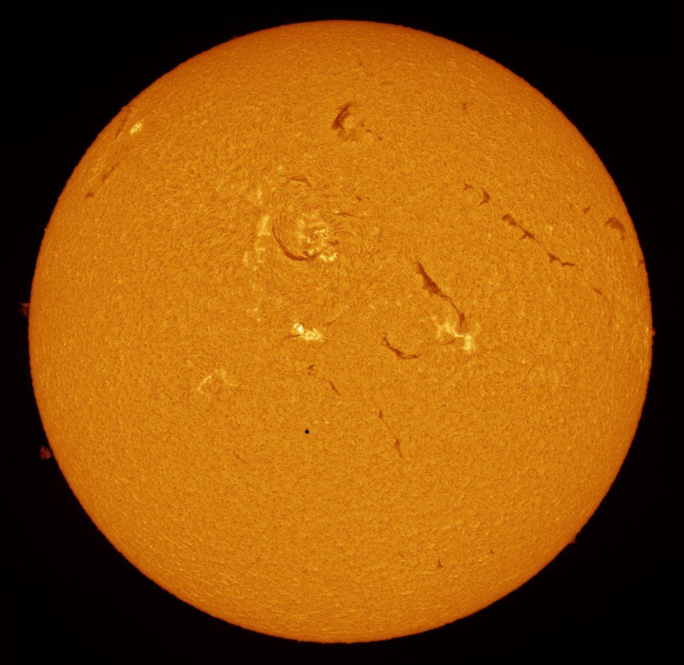 Mercury passing in front of the surface of the sun