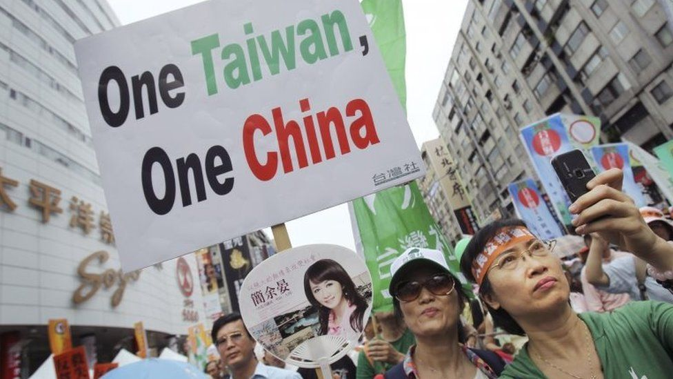 In this June 26, 2010 file photo, anti-China demonstrators hold placards denouncing the Economic Cooperation Framework Agreement (ECFA) planned with China, in Taipei, Taiwan.
