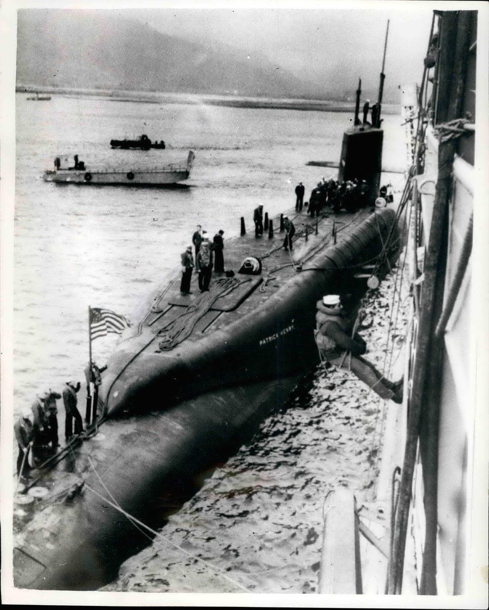 The 6700-ton American Polaris submarine ''Patrick Henry'' arrived in the Holy Loch, Firth of Clyde, today, and tied up alongside the submarine depot ship ''Porteus''