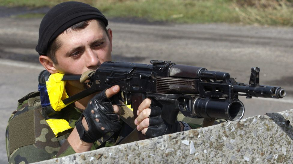 Ukrainian soldier at checkpoint near Slavyanoserbsk, eastern Ukraine, 10 Sep 14