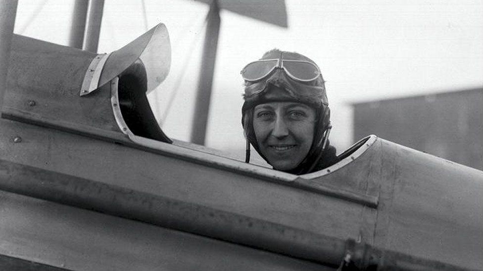 Amy Johnson sat in cockpit