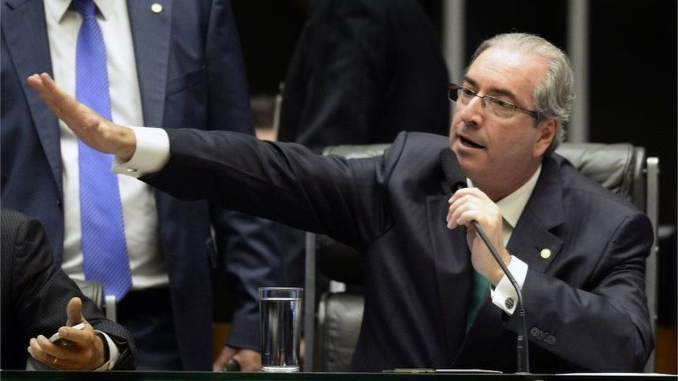 The president of the Chamber of Deputies Eduardo Cunha -who earlier this month had been indicted by the Supreme Court of taking $5 million in bribes as part of a vast embezzlement and bribery network centered on the country's national oil company Petrobras- gestures during the session in Brasilia on March 17, 2016
