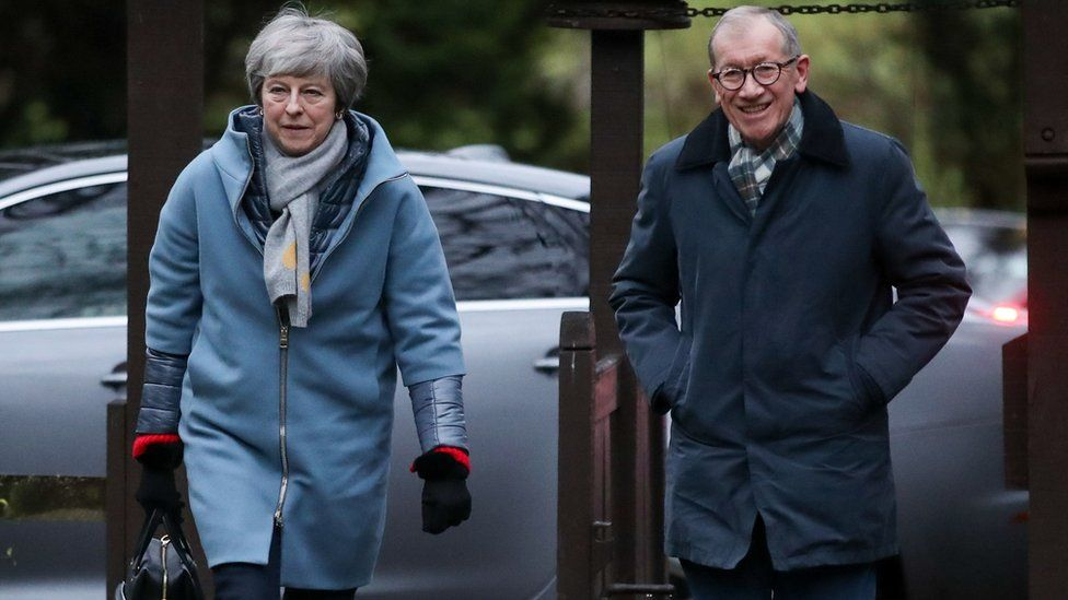 Theresa May and her husband Philip arrive for a church service on Sunday
