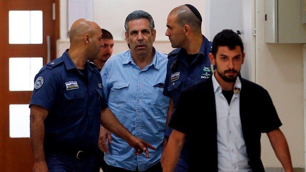 File photo showing Gonen Segev being led into court in Jerusalem on 5 July 2018