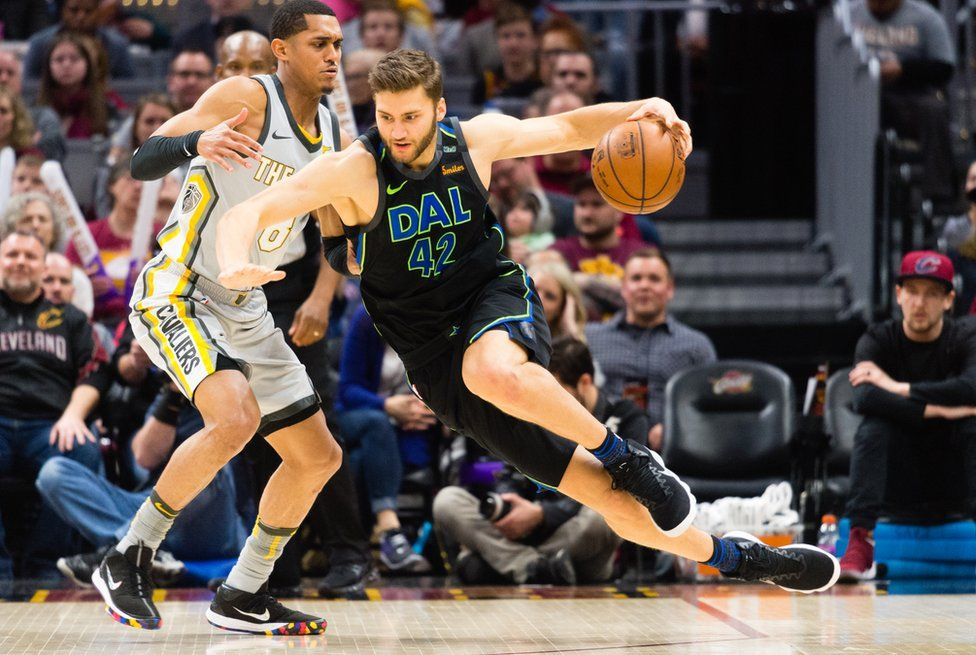 Maximilian Kleber of the Dallas Mavericks trying to get past Jordan Clarkson of the Cleveland Cavaliers