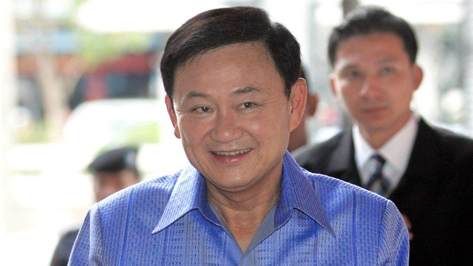 Thai Prime Minister Thaksin Shinawatra smiles as he arrives at Government House in Bangkok, 04 April 2006