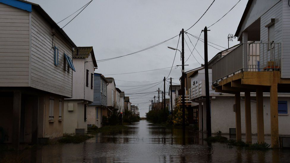 A street is closed by flood waters following heavy rains in Gruissan, southern France on October 23, 2019