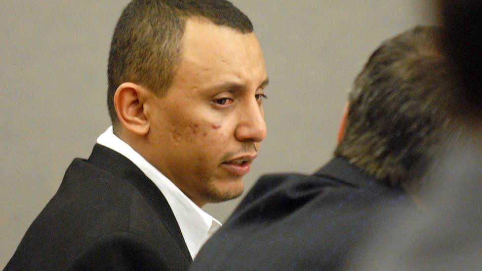 Khalid Adem speaks with his attorney in this Nov 2006 file photo