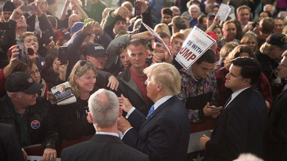 Donald Trump meets with fans at a campaign rally.