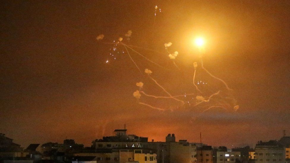 Israel's Iron Dome anti-missile system fires interceptor missiles as rockets are launched from the Gaza Strip towards Israel