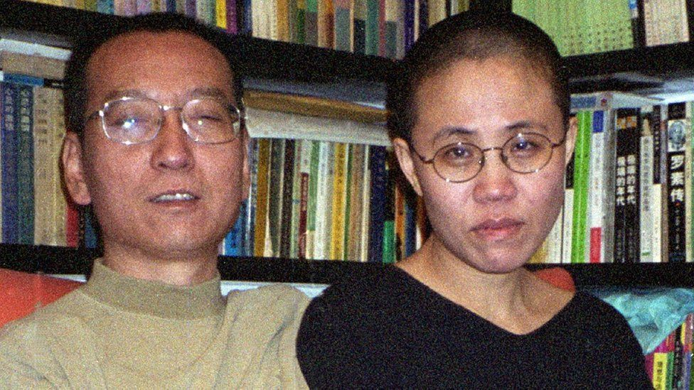 Chinese dissident and Nobel Peace laureate Liu Xiaobo (L) and his wife Liu Xia in Beijing