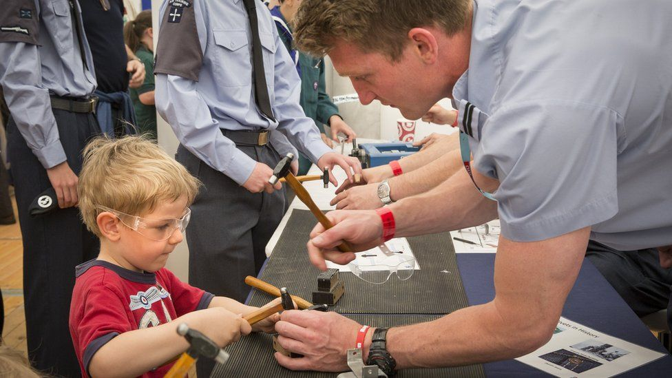 A youngster enjoys a STEM (Science, technology, engineering, and mathematics) activity.