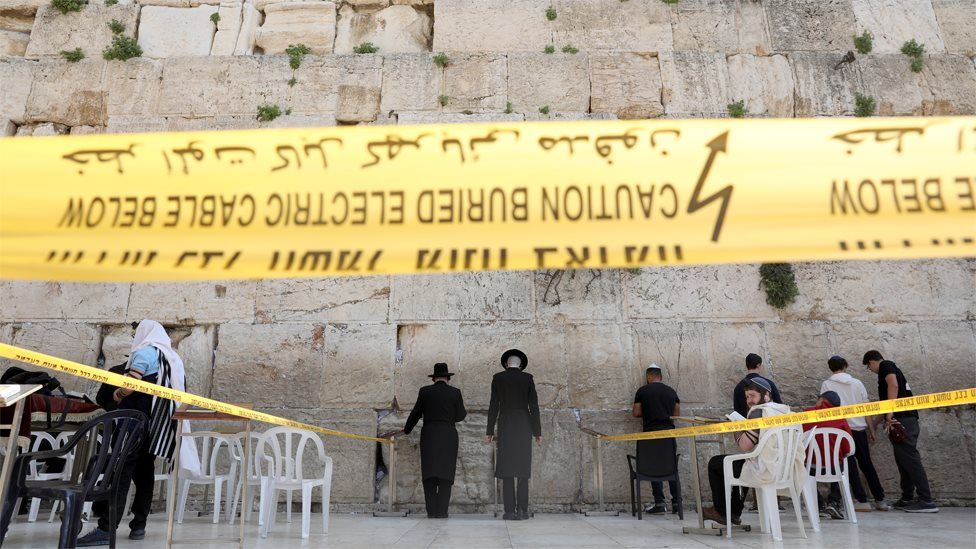Jews pray in an area restricted to 10 people at the Western Wall in Jerusalem (16 March 2020)