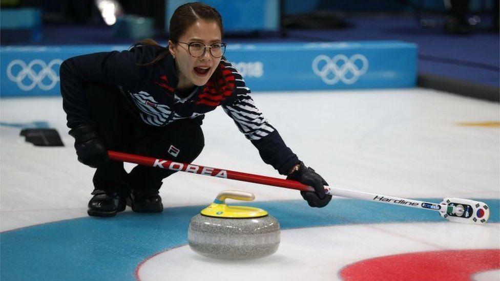 Skip Kim Eun-jung of South Korea shouts