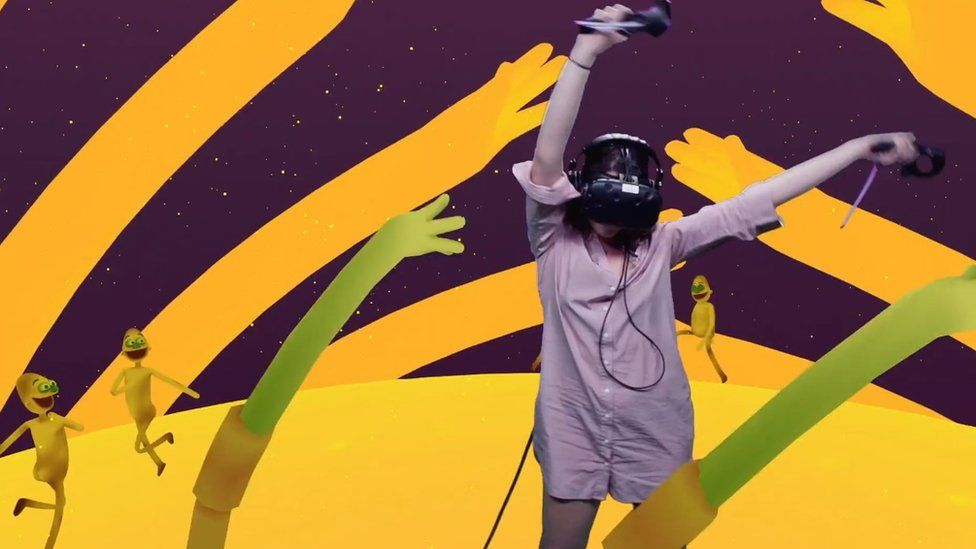 Woman wearing VR headset dancing with animations