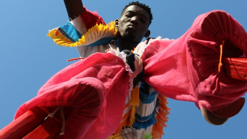 Shot of man on stilts in Sekondi Ghana