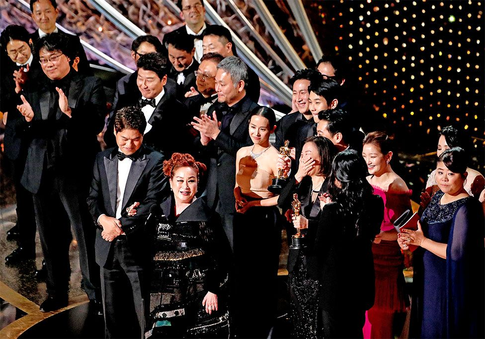 The cast and crew of Parasite accept their Oscar for best picture