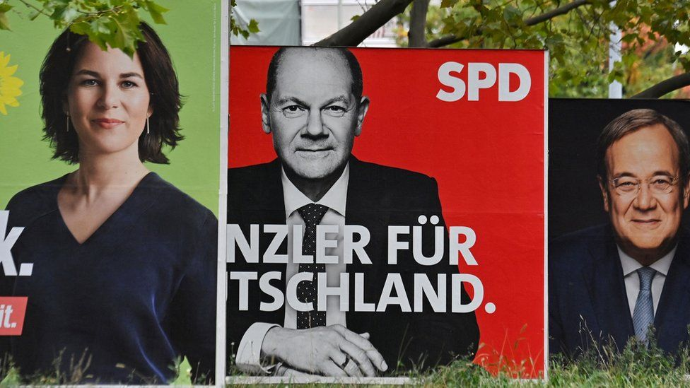 Billboards with election campaign posters showing the three chancellor candidates: co-leader of Germany's Greens (Die Gruenen) Annalena Baerbock; German Finance Minister and Vice-Chancellor of the Social Democratic SPD Party Olaf Scholz; and Christian Democratic Union CDU leader Armin Laschet