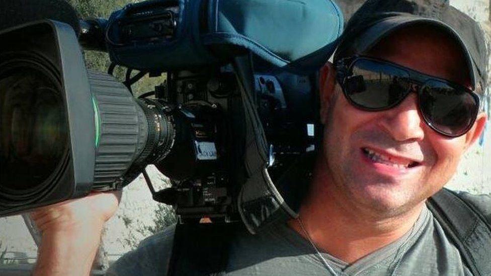 File picture of TV cameraman Ari Jr