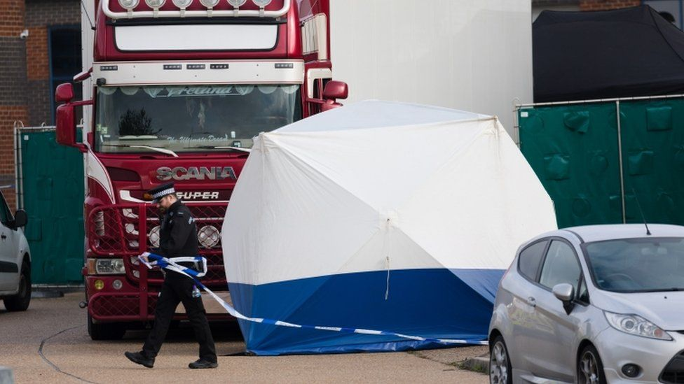 Officers inspect a lorry in Essex after finding 39 bodies inside