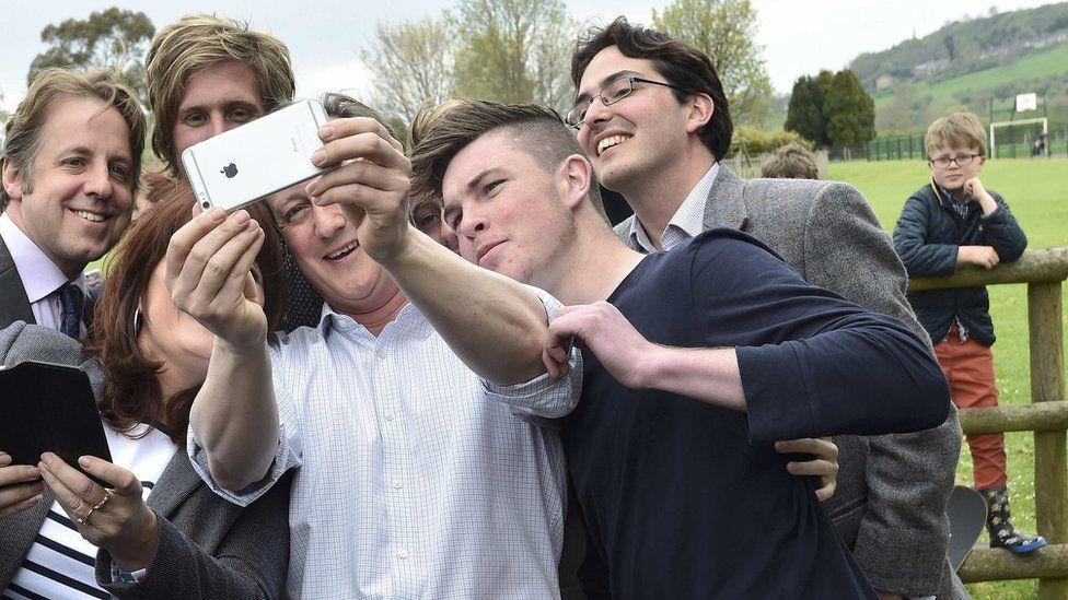 David Cameron with an iPhone