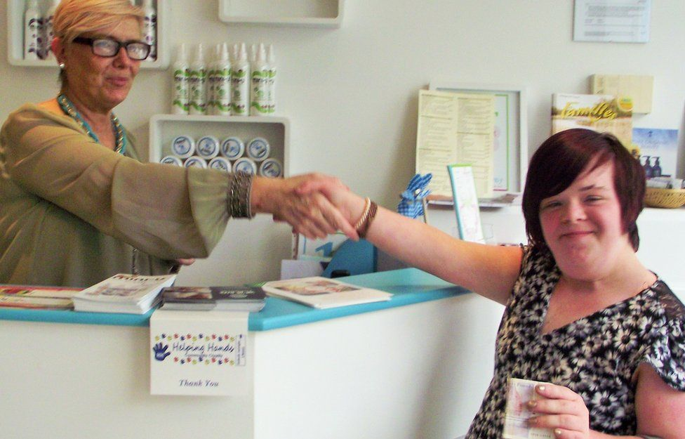 Heidi shaking hands with the owner of the salon