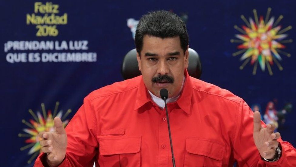 A handout picture provided by the press office of the Miraflores presidential palace shows the President of Venezuela Nicolas Maduro speaking during an official event in Caracas, Venezuela, 11 December 2016.