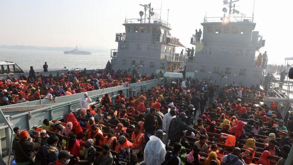 Rohingyas prepare to board a ship as they move to Bhasan Char island near Chattogram, Bangladesh