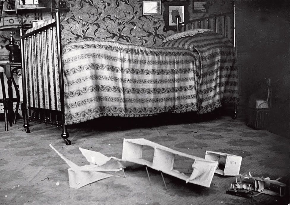 A photo of Lartigue's bedroom with a toy plane on the floor