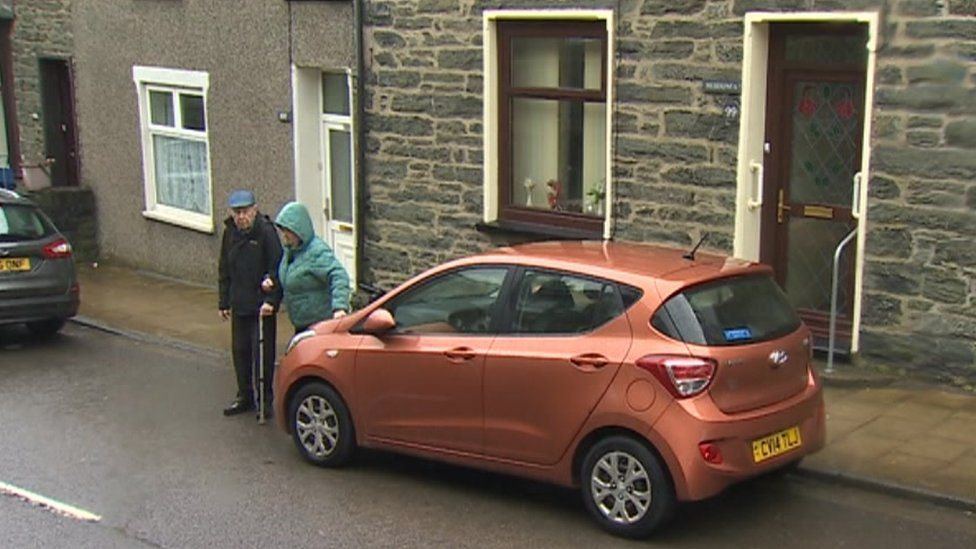 Couple's car outside their home