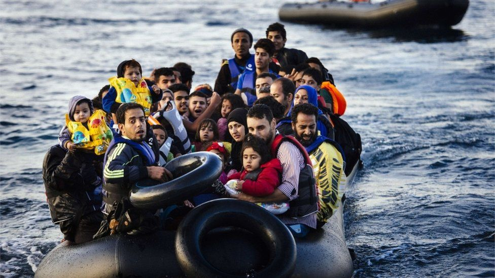 Migrants arriving by boat at Lesvos