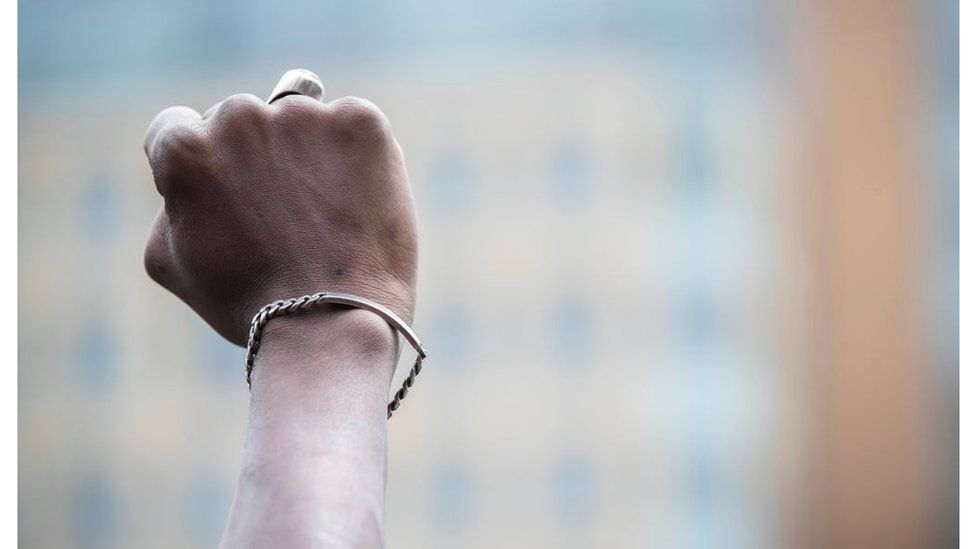 A black protester holds up a closed fist in New York