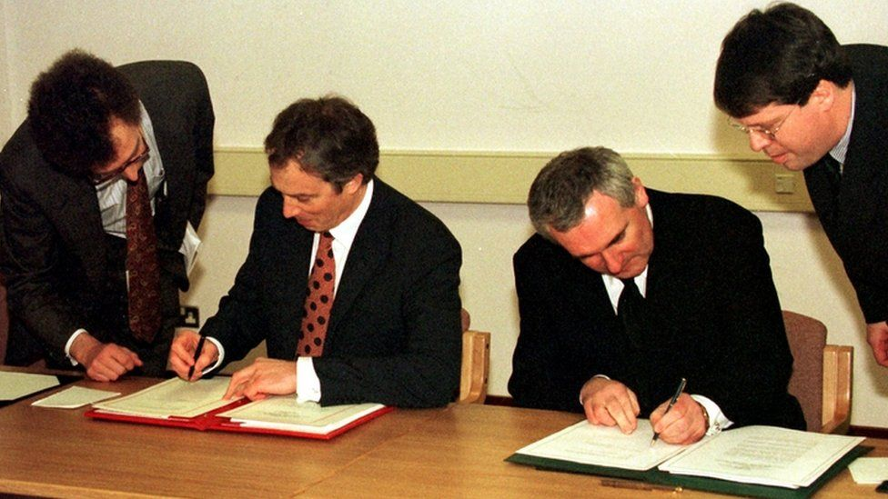 British Prime Minister Tony Blair and Taoiseach Bertie Ahern sign the Good Friday Agreement