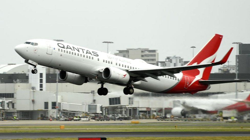 A Qantas plane takes off from the Sydney International airport on May 6, 2021