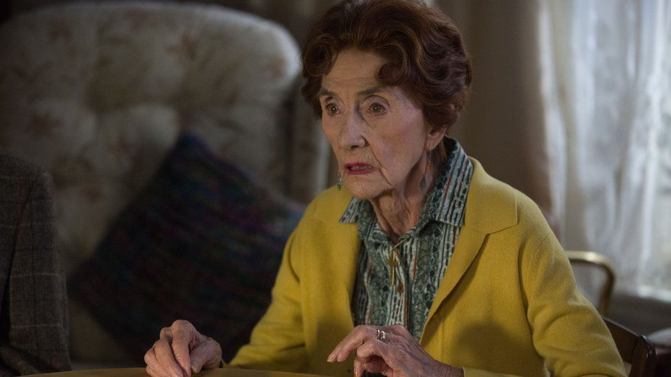 June Brown as Dot Branning. Dr. Legg's solicitor comes to see Dot about the will.