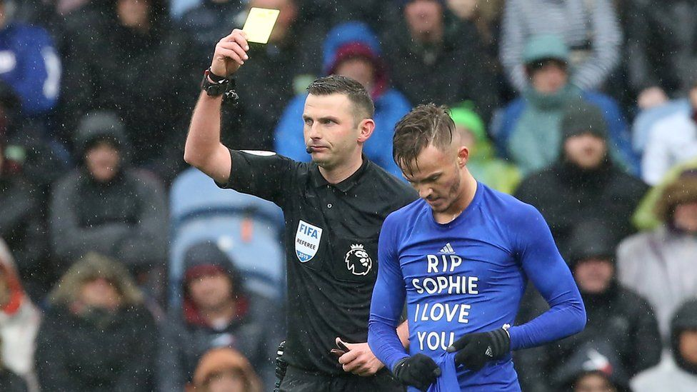 James Maddison of Leicester City is booked by referee Michael Oliver