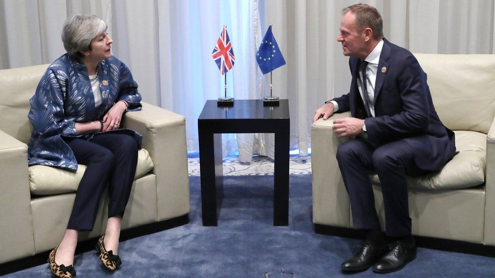 British Prime Minister Theresa May (L) and European Union Council President Donald Tusk