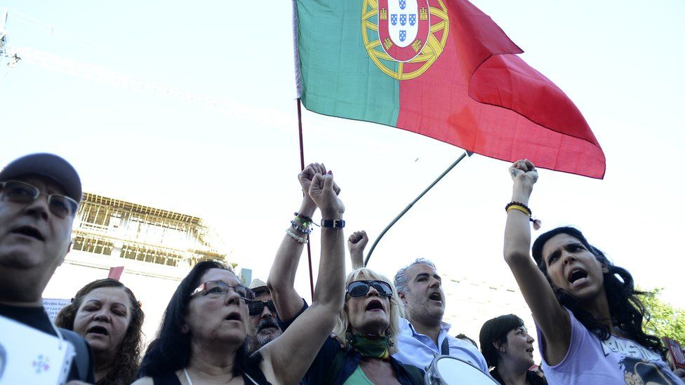 Portuguese people protesting against the terms of the 2011 financial bailout of the country
