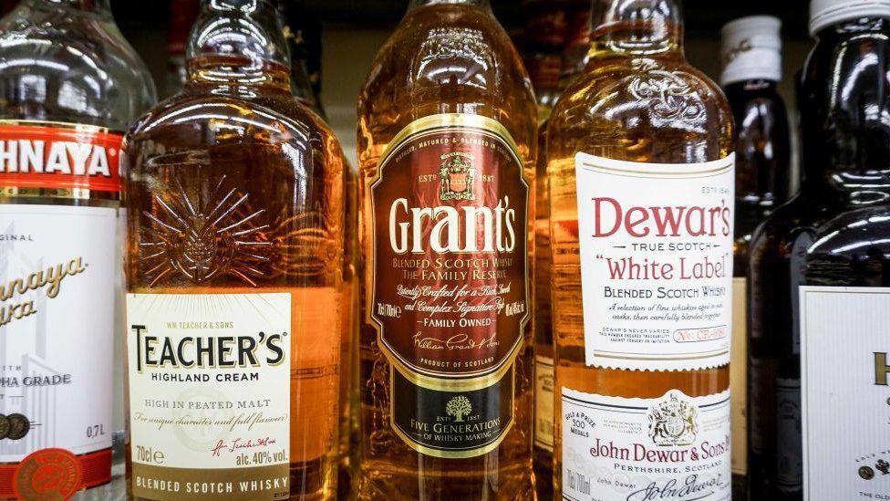 Whiskies on display in supermarket