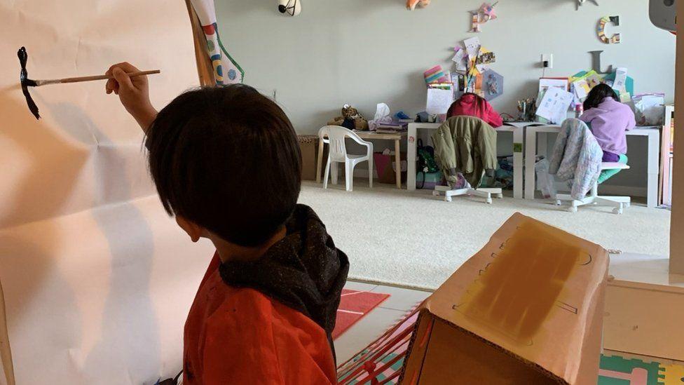 Julie Lam's children working hard at home