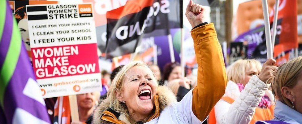 Thousands of women march in Glasgow in one of the biggest strikes over equal pay in the UK.