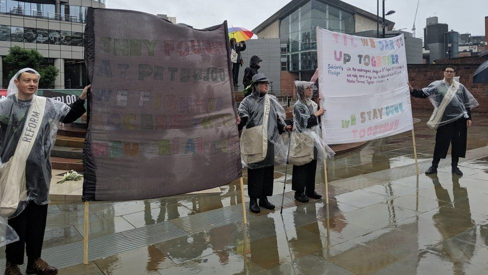 Protesters campaigning over the lack of disabled access to the Peterloo Memorial