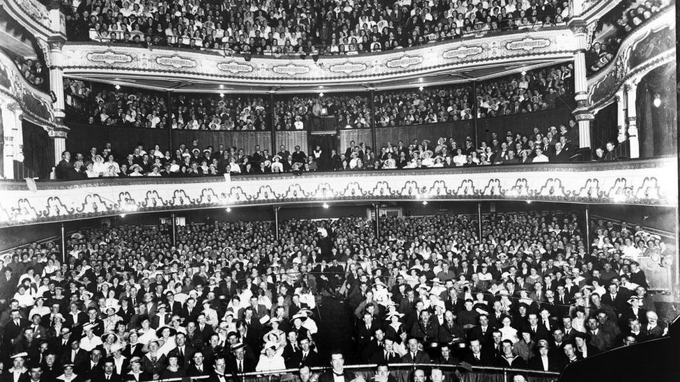 A black and white photograph of a Grand Opera House audience in 1916